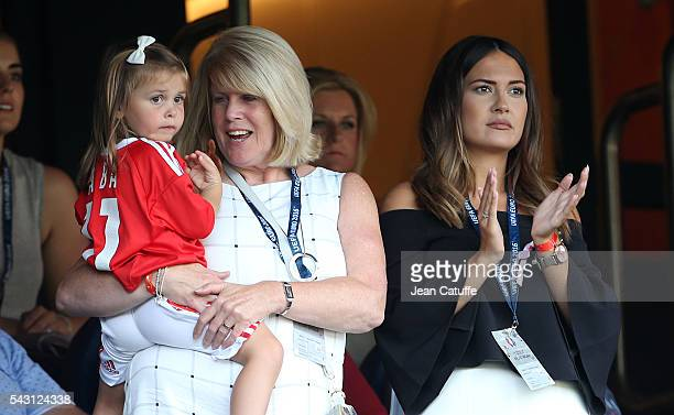 Debbie Bale Gareth Bales' mother holding her granddaughter Alba Bale and Emma RhysJones wife of Gareth Bale attend the UEFA EURO 2016 round of 16...