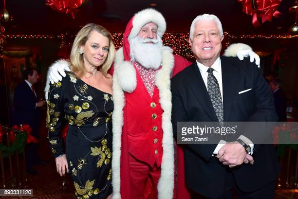 Debbie Bancroft Santa Claus and Dennis Basso attend A Christmas Cheer Holiday Party 2017 Hosted by George Farias and Anne and Jay McInerney at The...