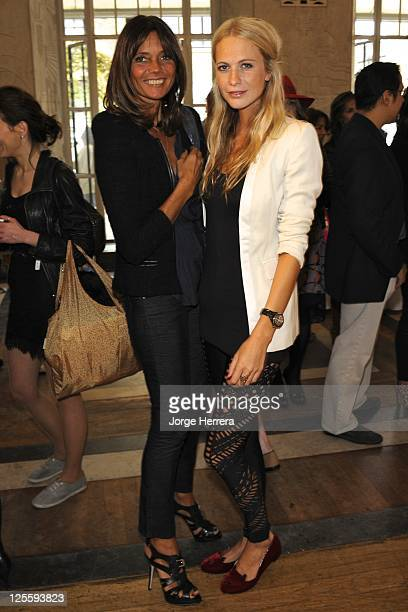 Debbie Bismarck and Poppy Delevingne attend the Charlotte Olympia S/S 2012 presentation during London Fashion Week at the Royal Institute of British...
