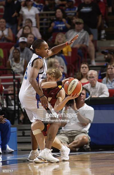 Debbie Black of the Miami Sol is defended by Elaine Powell of the Orlando Miracle in the game on June 15 2002 at TD Waterhouse Centre in Orlando...