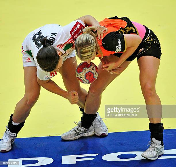 Debbie Bont of The Netherlands and Hungarian Aniko Kovacsics fight for the ball during the 9th Women's Handball European Championships main round...
