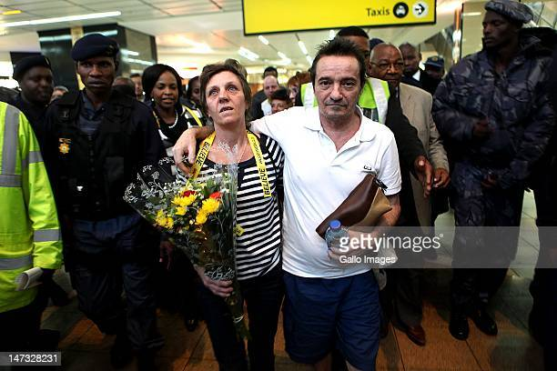 Debbie Calitz and Bruno Pelizzari at their arrival at the OR International Airport on June 27 2012 in Johannesburg South Africa The couple was...