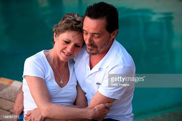 Debbie Calitz and Bruno Pelizzari relax at his sister's home on July 12 2012 in Durban South Africa Pelizzari and Debbie Calitz arrived in Durban...