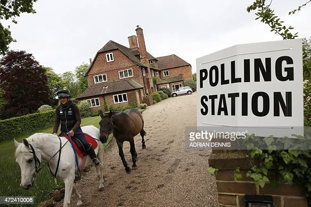 Debbie Carpenter an equestrian groom rides back to Three Oaks a residential house where a polling station is set up in Bramshill near Reading at a...
