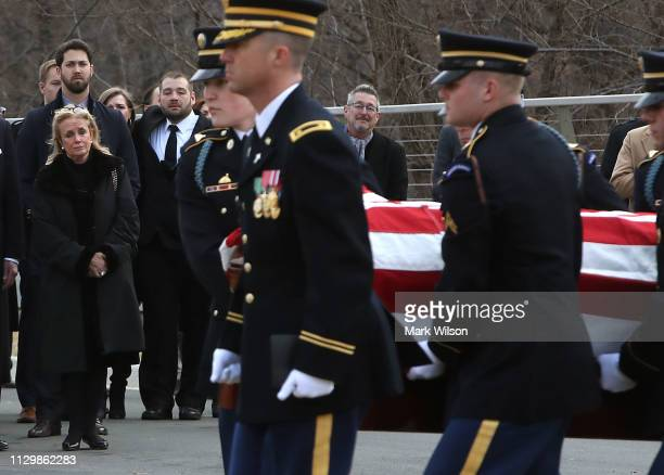 Debbie Dingell watches as the casket carrying the remains of her husband former Rep. John Dingell during a funeral service at Arlington National...