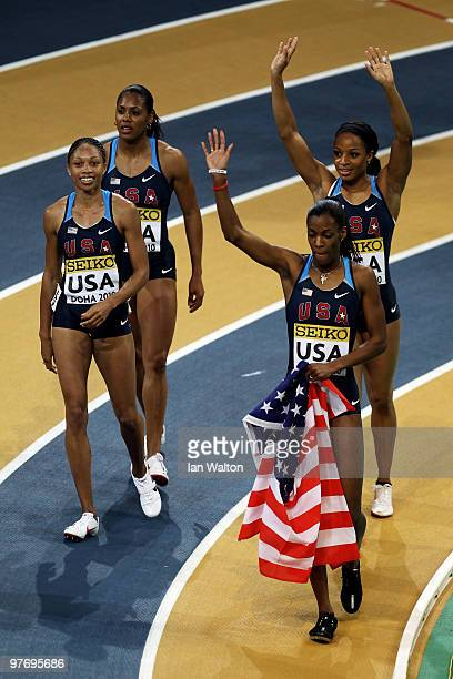 Debbie Dunn Deedee Trotter Natasha Hastings and Allyson Felix of USA celebrate victory in the Womens 4 x 400m relay during Day 3 of the IAAF World...