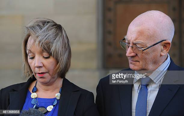 Debbie Essery and her father Keith Rathband are seen as she reads a statement to the media following the suicide verdict in the inquest into the...