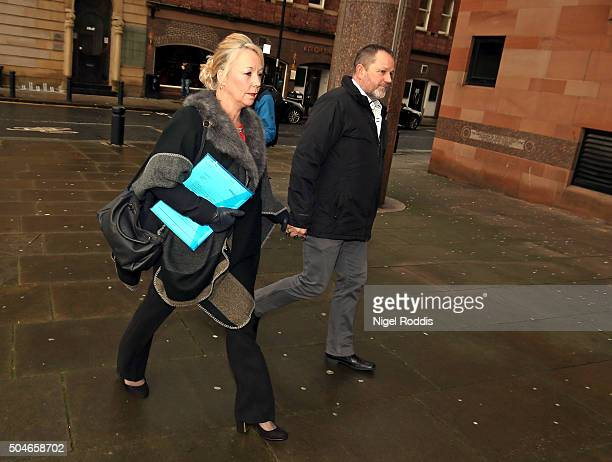 Debbie Essery sister of PC David Rathband and her husbamd Paul Essery arrive ahead of the family's court case against Northumbria police at Newcastle...