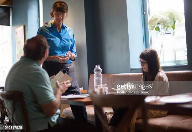 Debbie Gilmour a server at Solo Italiano talks to patrons at the restaurant on Saturday July 28 2018