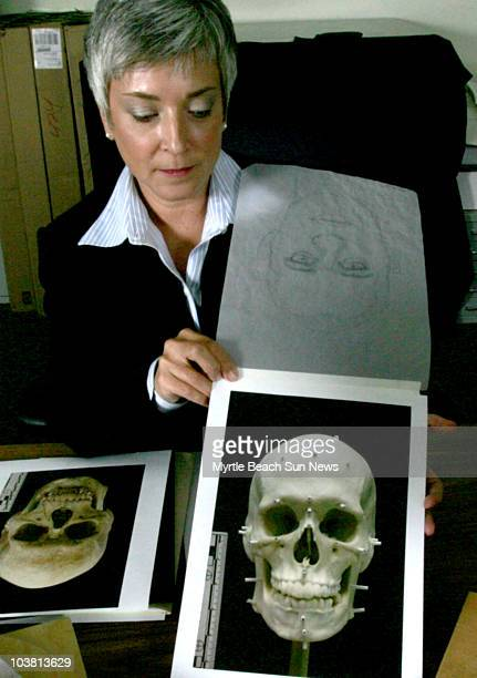 Debbie Goff a forensic artist with the SC Law Enforcement Division displays a photo of the model made from the skull of an unidentified murder victim...