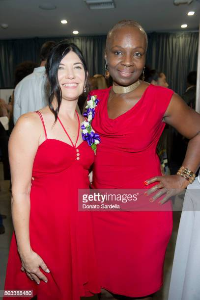Debbie Hannah and JoAnn Diaz de Leon at Living Beauty 'The Gift' Photo Exhibit at The Buterbaugh Gallery on October 19 2017 in Los Angeles California