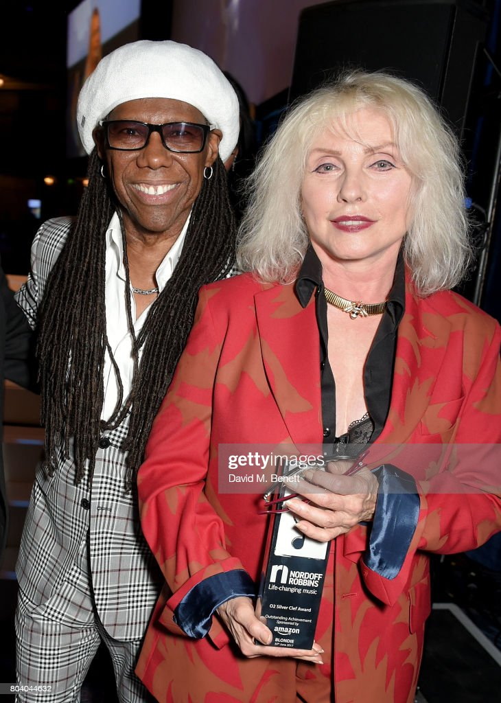 Debbie Harry and Nile Rodgers with Blondie's Amazon Outstanding Achievement Award at the Nordoff Robbins O2 Silver Clef Awards at The Grosvenor House Hotel on June 30, 2017 in London, England.