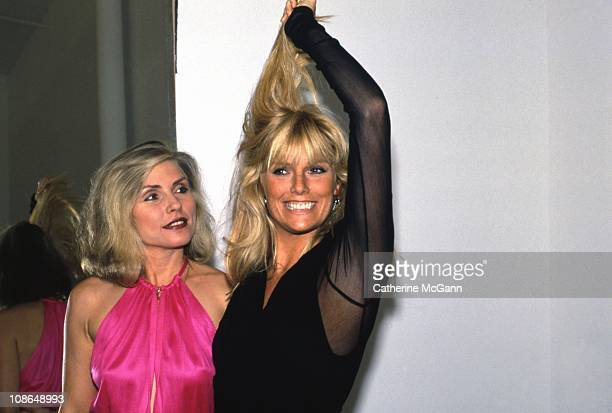 Debbie Harry and Patti Hansen pose for a photo at Hair Cares benefit on August 10 1988 in New York City New York