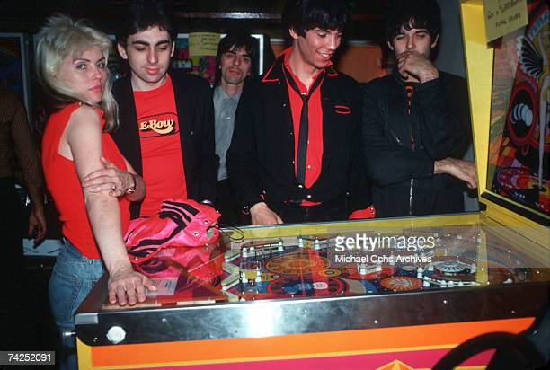 Debbie Harry Chris Stein Clem Burke Jimmy Destri and Nigel Harrison of the New Wave pop group 'Blondie' pose for a portrait at a pinball machine in...