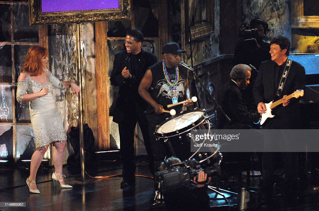 Debbie Harry of Blondie, inductee, dances with Robbie Robertson and band members during the New Orleans Tribute