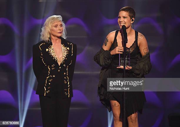 Debbie Harry presents Halsey with an award on stage at the Billboard Women in Music 2016 event on December 9 2016 in New York City