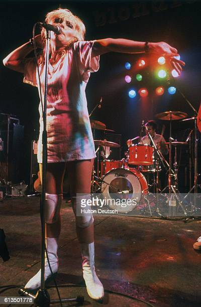 Debbie Harry the American pop singer actress and lead singer of the group 'Blondie' performing on stage