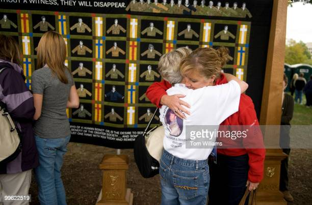 Debbie Lee right who lost her Marc Alan Lee a Navy SEAL killed in Iraq hugs Jonnie Chandler who lost her son Capt Jeremy Chandler an Army Special...