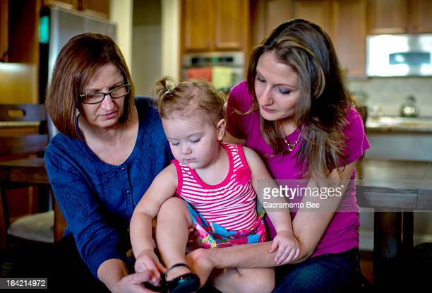 Debbie Long, left, with her daughter Robin Deller and granddaughter Brooklynn in West Sacramento, California, on March 13, 2013. Worries about...