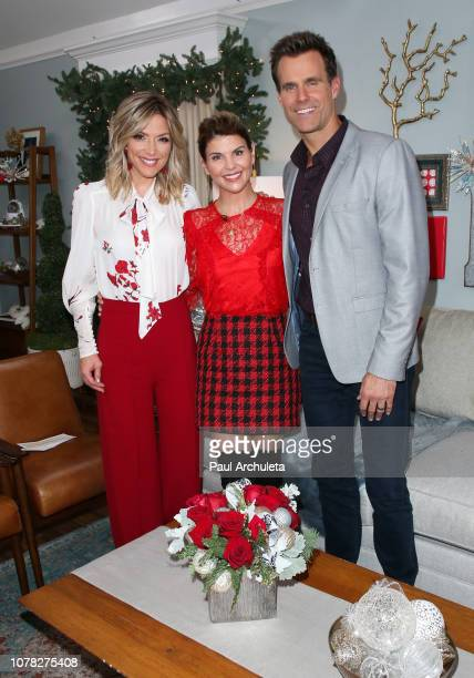 Debbie Matenopoulos Lori Loughlin and Cameron Mathison on the set of Hallmark's Home Family at Universal Studios Hollywood on December 06 2018 in...