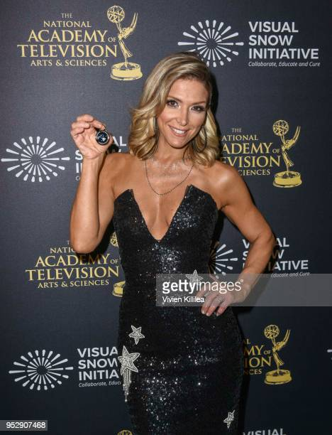 Debbie Matenopoulos poses with TAP medallion at 45th Daytime Emmy Awards Backstage with the Visual Snow Initiative on April 29 2018 in Los Angeles...