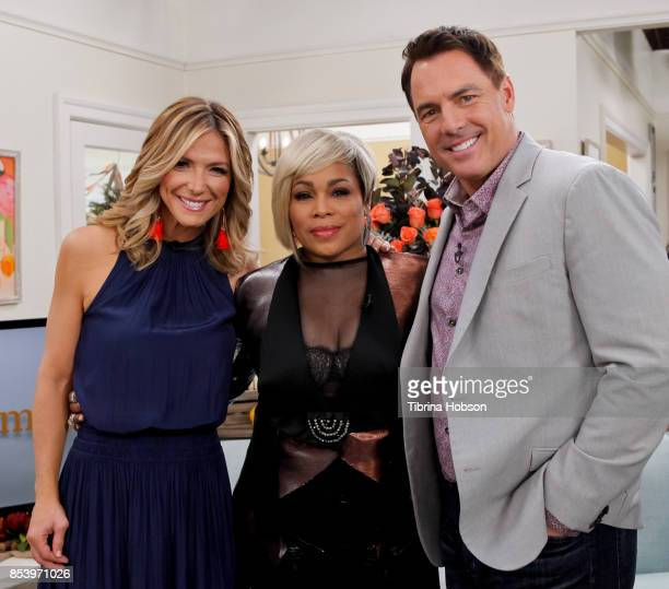 Debbie Matenopoulos TBoz and Mark Steines pose for a photo on the set of Hallmark's 'Home and Family' at Universal Studios Hollywood on September 25...
