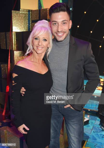 Debbie McGee and Giovanni Pernice pose backstage following the cast change press night performance of 'Annie' at The Piccadilly Theatre on October 2...