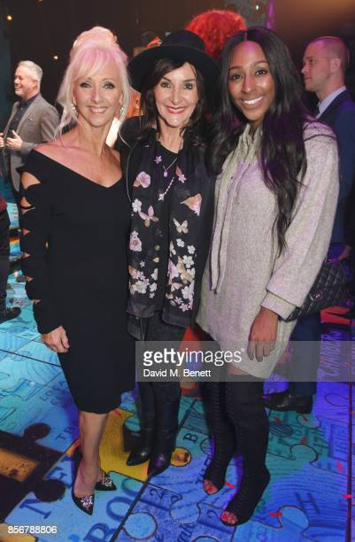 Debbie McGee Shirley Ballas and Alexandra Burke pose backstage following the cast change press night performance of 'Annie' at The Piccadilly Theatre...