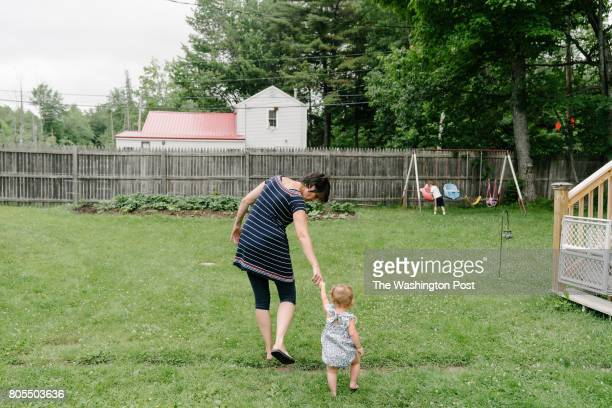 Debbie McLaughlin of Greenbush Me guides an infant in foster care into her backyard to play with her 3yearold grandson on Friday June 30 2017...