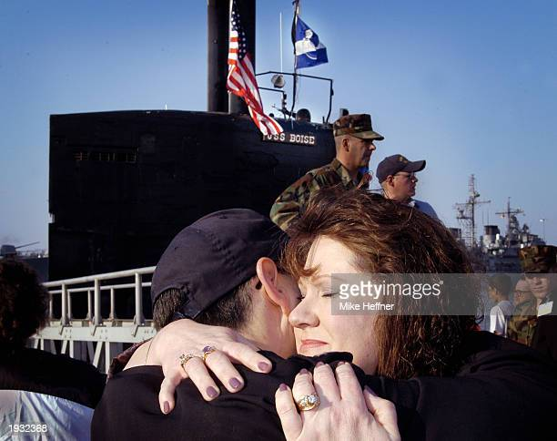 Debbie Moyock of Moyock North Carolinia hugs her husband Lt Tom Meyer after the nuclear attack submarine USS Boise returned home to Norfolk Naval...