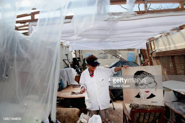 Debbie Powell looks over damage to her trailer caused by Hurricane Michael on October 15 2018 in Panama City Florida Hurricane Michael slammed into...