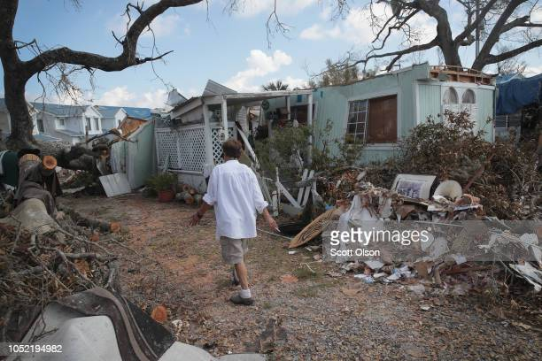 Debbie Powell walks to her trailer in Water's Edge RV Park which was damaged by Hurricane Michael on October 15 2018 in Panama City Florida Hurricane...