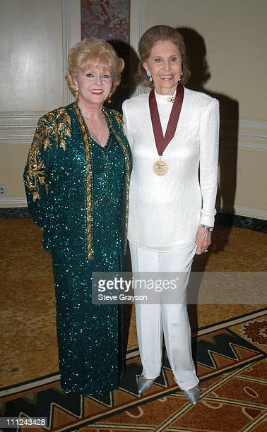 Debbie Reynolds and Cyd Charisse during 2003 Music Center Artist Awards at The Beverly Regent Hotel in Los Angeles California United States