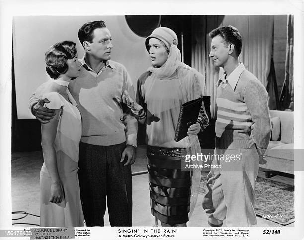 Debbie Reynolds and Gene Kelly listen to Jean Hagen and Donald O'Connor in a scene from the film 'Singin' In The Rain' 1952