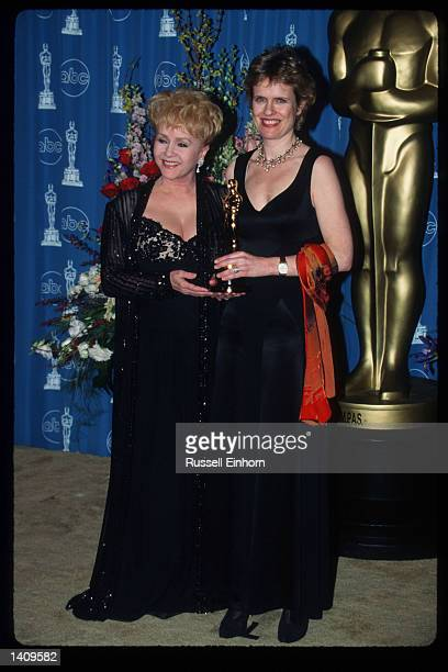Debbie Reynolds and Rachel Portman hold the award for Best Original Score For A Musical Or Comedy for Emma at the 69th Annual Academy Awards ceremony...
