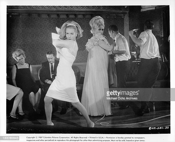 Debbie Reynolds dancing in club in a scene from the film 'Divorce American Style' 1967