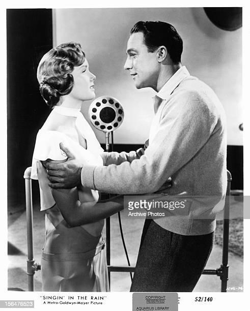 Debbie Reynolds holds Gene Kelly in a scene from the film 'Singin' In The Rain' 1952