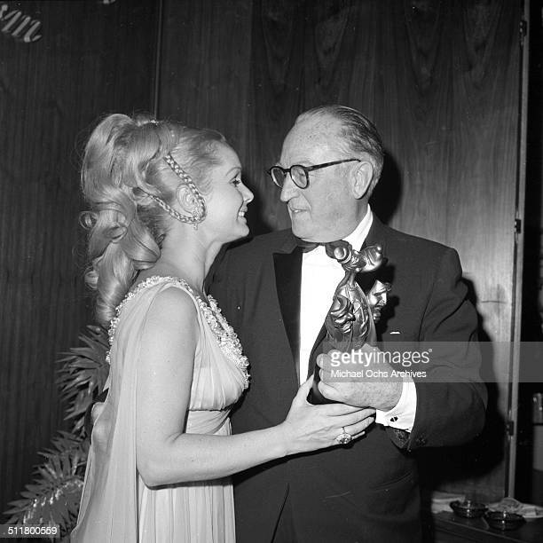 Debbie Reynolds presents the second annual Thalians ' MrWonderful' award to Harold Lloyd at Greek Theater in Los AngelesCA