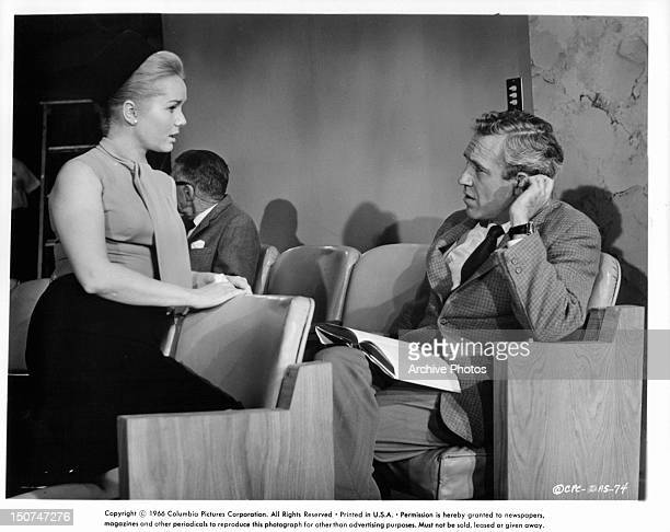 Debbie Reynolds turns around in her seat to talk with Jason Robards who was reading in a scene from the film 'Divorce American Style' 1967