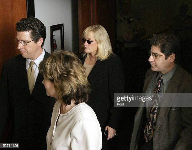 Debbie Rowe Michael Jackson's exwife and mother of two of his children is surrounded by people as she leaves the courtroom after court adjourns for...