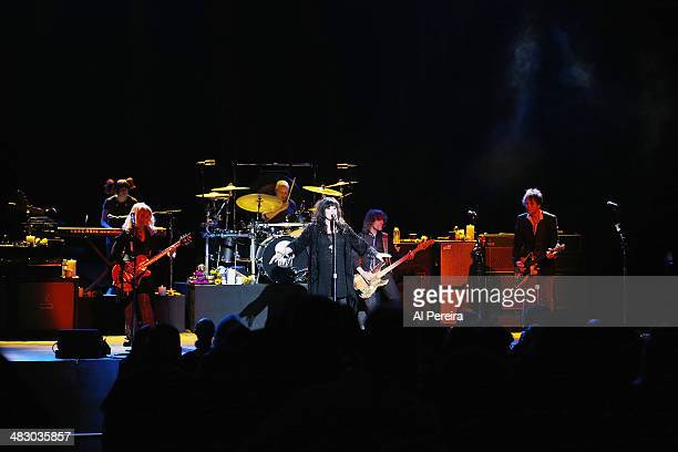 Debbie Shair Ben Smith Nancy WIlson Ann Wilson Dan Rothchild and Craig Bartock of Heart perform at Bergen Performing Arts Center on April 5 2014 in...