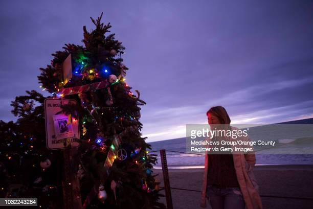 Debbie Sheldrake stands next to the tree she's brought down to Calafia State Beach for the public to decorate in San Clemente on Wednesday, Dec. 20,...