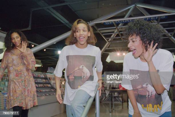 Debbie Sledge Kim Sledge and Joni Sledge of American vocal group Sister Sledge perform together at an instore appearance at the HMV record store in...