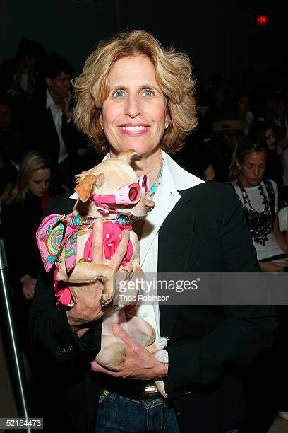 Debbie Stark and her dog Lucy Anne attends the Sass & Bide Fall 2005 show during Olympus Fashion Week at Bryant Park February 7, 2005 in New York...