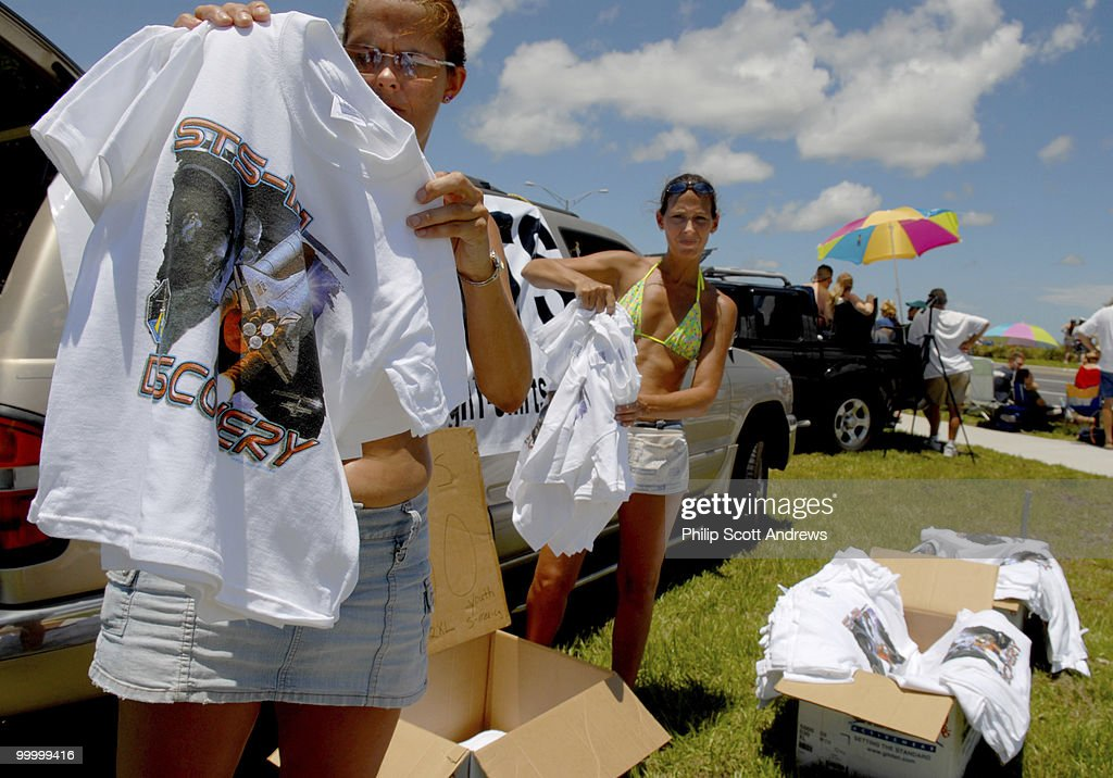 Debbie Stonecipher and her sister Diana Stonecipher sell STS-121 t-shirts for 10 dollars on the side of route 1 in Titusville, Fla. many people are gathering here to watch the launch of the Space Shuttle Discovery from Kennedy Space Center 11.8 miles to the east. The sisters have been selling mission shirts for the last few years and say there glad the space program seems to be back on its feet.