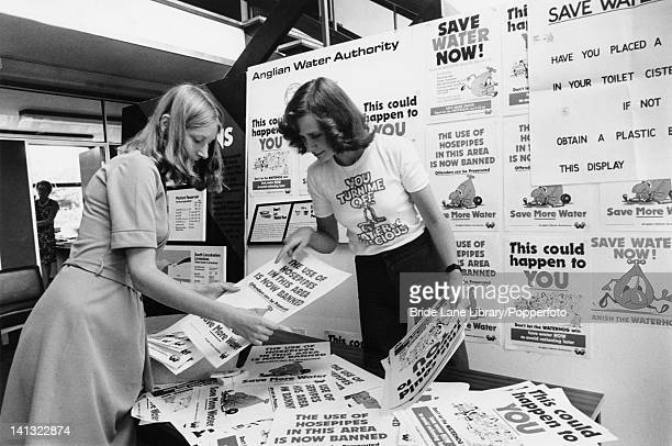 Debbie Tuft , of the Anglian Water Authority, and a colleague sort through posters for a campaign to conserve water during Britain's worst drought...