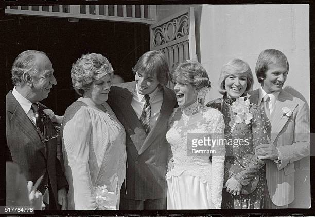 Debby Boone and her husband Gabriel Ferrier are flanked by their parents Jose Ferrer and Rosemary Clooney parents of the groom and at right Pat and...