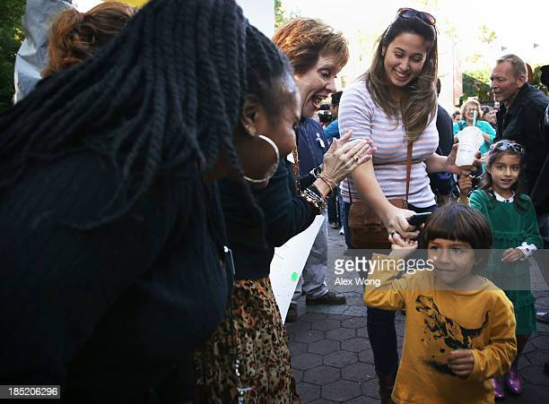 Debby Kelly wife of National Zoo Director Dennis Kelly joins the staff of the National Zoo and Friends of the National Zoo to welcome visitors by the...