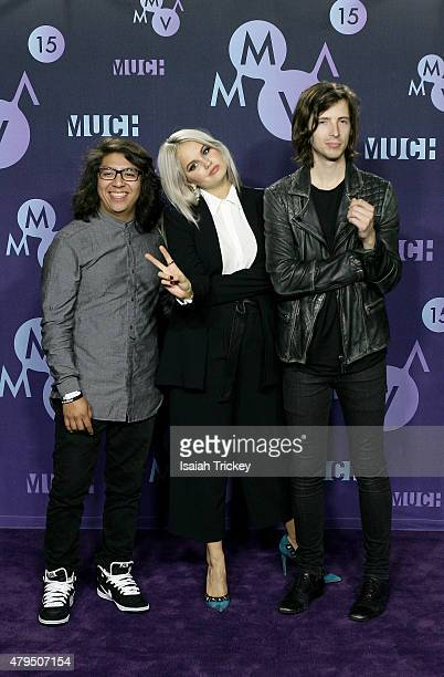 Debby Ryan and guests pose in the press room at the 2015 Much Music Video Awards at MuchMusic HQ on June 21 2015 in Toronto Canada