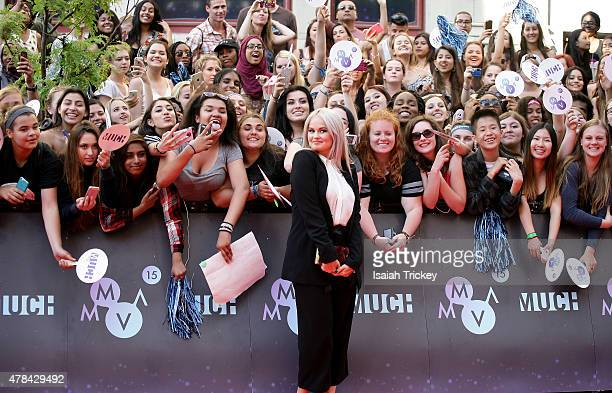 Debby Ryan arrives at the 2015 MuchMusic Video Awards at MuchMusic HQ on June 21 2015 in Toronto Canada